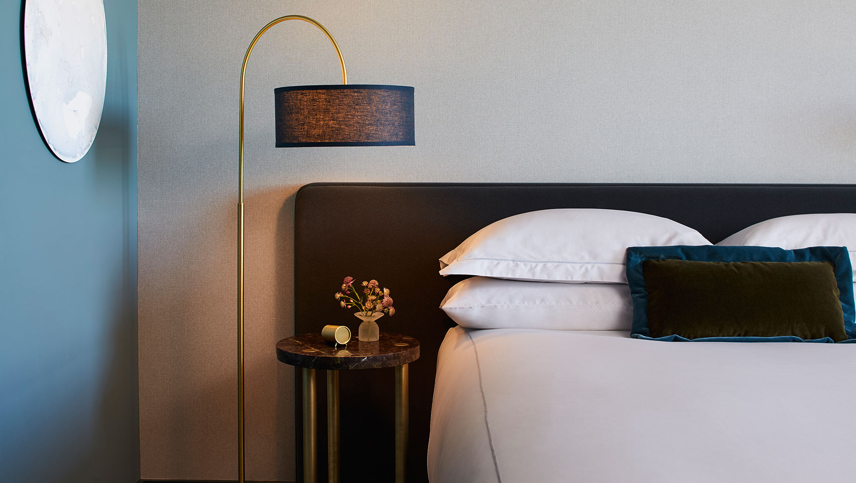 Kimpton Saint George guest bed and side table
