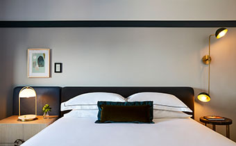 King bed, Black Headboard, white sheets